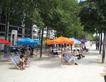 beach umbrella, sand ... it's Paris Plage in summer